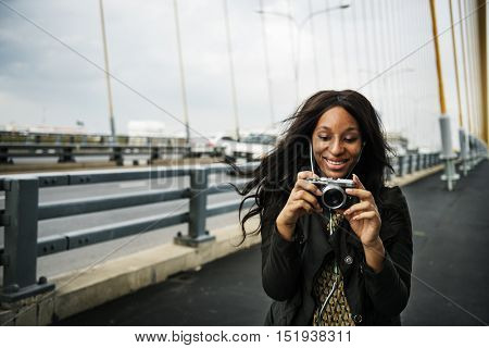 African Woman Listening Music Media Entertainment Camera Concept