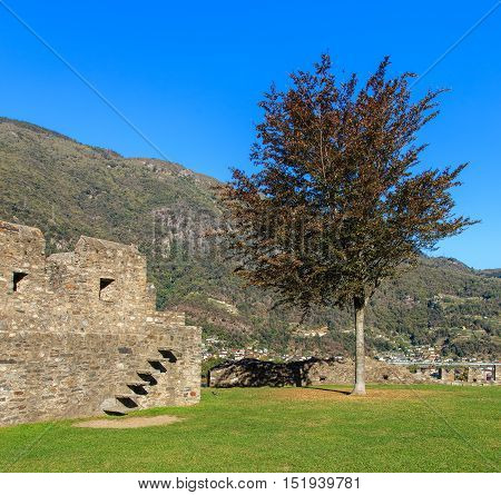 View inside the Castelgrande fortress in Bellinzona, Switzerland mountains in the background. The Castelgrande fortress is a UNESCO World Heritage Site. The city of Bellinzona is the capital of the Swiss canton of Ticino.