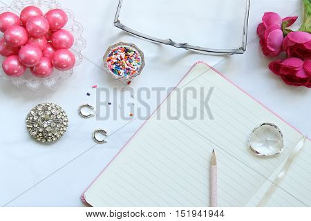 Over head flat lay of whimsical, colorful desktop