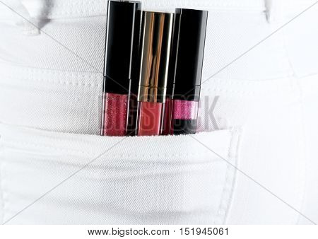 Lip gloss in jeans pocket, close up