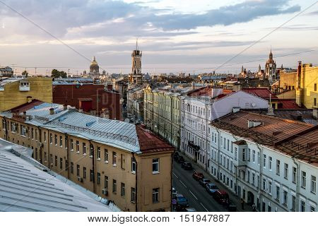 Saint-Petersburg.Russia. 1 july 2016. The view from the height on the building of the Spasskaya Fire station No. 2 and Isaac cathedral and the roof at sunset in St. Petersburg.