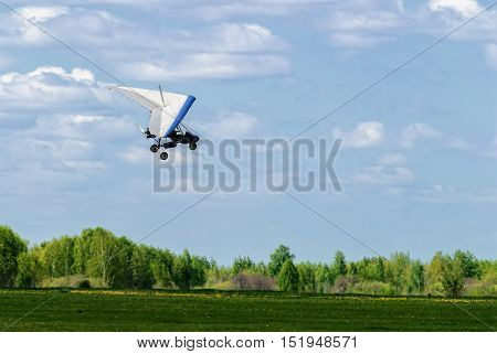 Yalutorovsk, Russia - May 24. 2008: The motorized hang glider above forest at sport airdrome