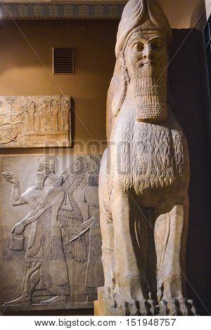 Moscow, Russia - October 04, 2016 - Antique sculpture of sphinx and human murals in Egyptian room of Pushkin state museum of fine arts