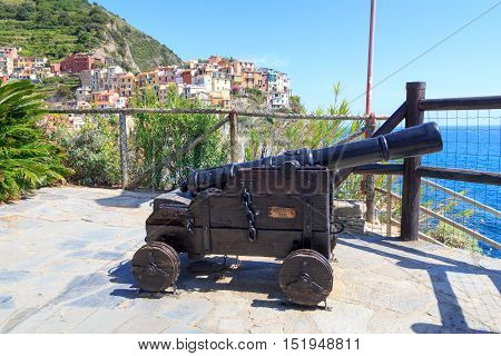 Old Cannon And Cinque Terre Village Manarola With Colorful Houses And Mediterranean Sea, Italy