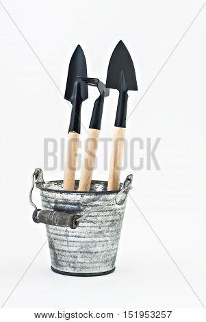 Garden Shovel, Rake And A Metal Bucket Isolated