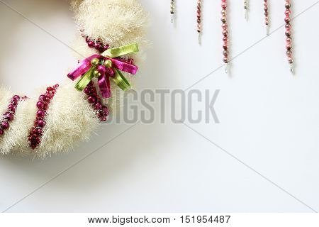 Over head view of vintage Christmas decorations, wreath and icicles
