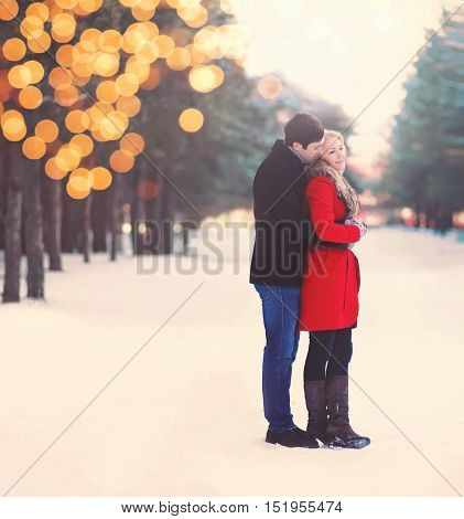 Silhouette Of Loving Couple Embracing In Warm Winter Day, Christmas Lights Bokeh, Vintage Soft Color