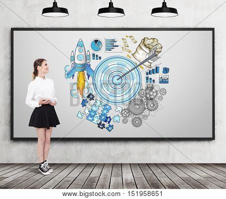Woman in wide skirt is standing near whiteboard with target sketch on it. Concept of stating your goals and reaching them