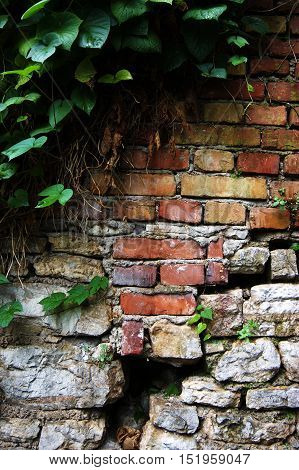 Old red brick wall with a crack