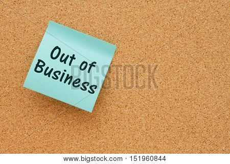 Out of Business notice Bulletin board with a teal sticky note with text Out of Business