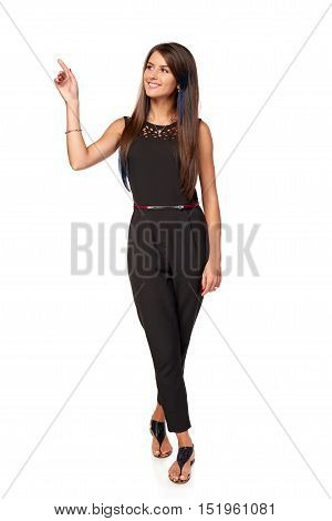 Happy business woman pointing to the side at blank copy space, full length portrait, over white background