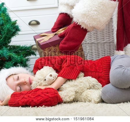 Santa Claus Delivering Presents While Kids Are Sleeping.