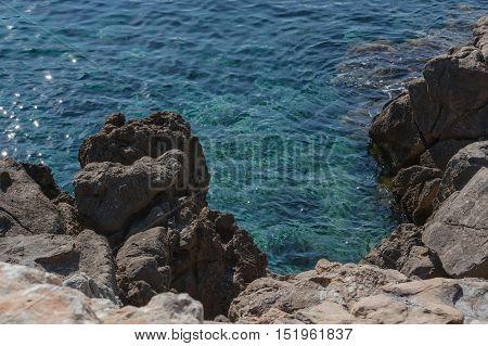 Small rocks in the blue Mediterranean Sea on Majorca's coast.