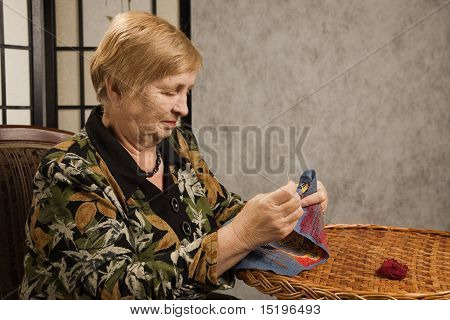 Old Woman With A Needle