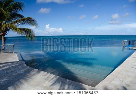 Beautiful Caribbean Sunrise Next To An Infinity Pool