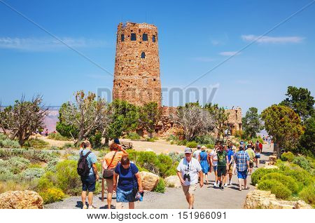 GRAND CANYON VILLAGE AZ - AUGUST 20: Crowded with people Desert View Watchtower point at the Grand Canyon National park on August 20 2015 in Grand Canyon Village AZ.