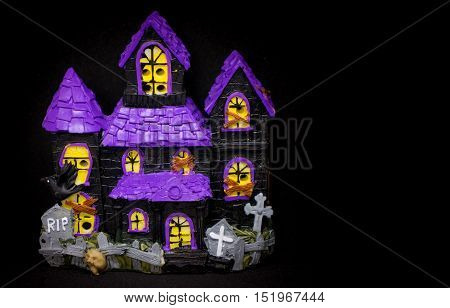 Toy Ghost house with copy space for halloween