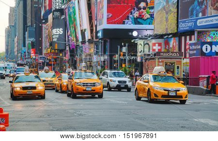 NEW YORK CITY - SEPTEMBER 04: Yellow cabs at Times square on October 4 2015 in New York City. It's major commercial intersection and neighborhood in Midtown Manhattan at the junction of Broadway and 7th Avenue.