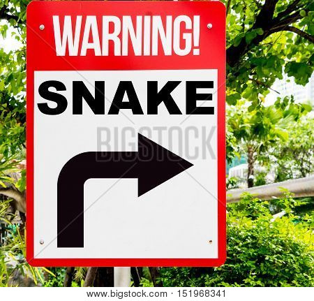 Red Snake warning sign in the forest