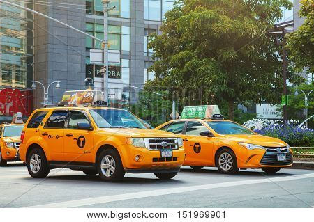 NEW YORK CITY - SEPTEMBER 05: Yellow cabs in the morning on October 5 2015 in New York City. It's the most populous city in the United States[1] and the center of the New York metropolitan area.