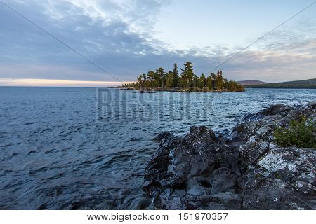 Uninhabited Island In Lake Superior. Small remote island off the rocky coast of Lake Superior in Copper Harbor, Michigan.