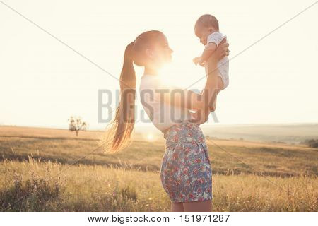Epic Portrait Of Mother And Baby On Sunset Outdoors