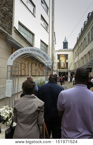 Paris France - September 6 2016: Gate of Mercy in connection with the year of charity established by Pope Francis next to the Church of the Miraculous Medal in Paris France