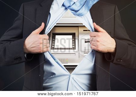 Close up of businessman's torso with ATM machine instead of heart. Concept of soulless businessperson
