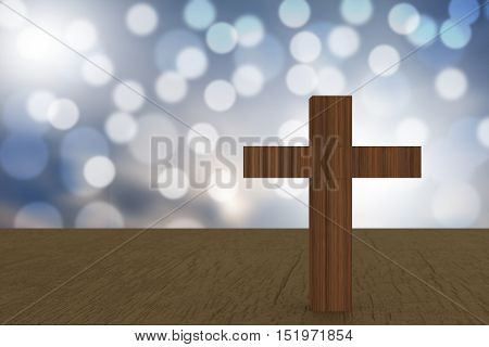 3D Rendering Of Wooden Cross On A Blue  Bokehs On A Table
