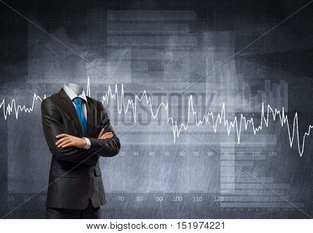 Headless businessman with arms crossed on chest in black suit