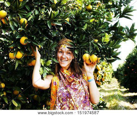 pretty islam woman in orange grove smiling, real muslim girl