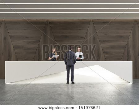 Rear view of man talking to receptionists in room with dark wood walls and concrete floor. Concept of business communication. 3d rendering.