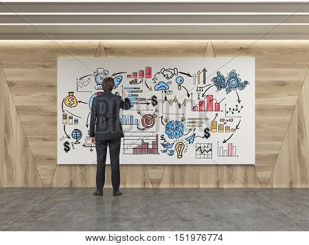 Rear view of man drawing startup sketch on whiteboard in room with wooden walls. Concept of business education. 3d rendering.
