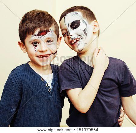 zombie apocalypse kids concept. Halloween party celebration facepaint on children dead bride, scar face, skeleton together close up