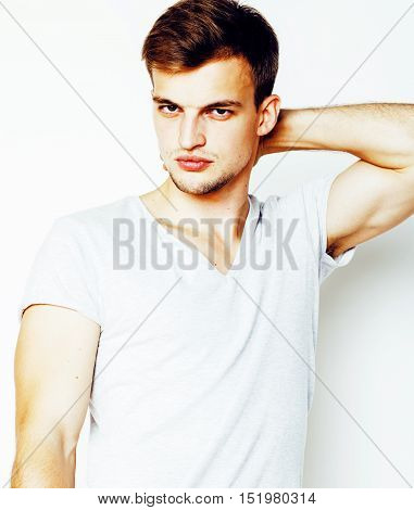 young handsome man on white background gesturing, pointing, posing emotional, cute guy sexy, lifestyle people concept