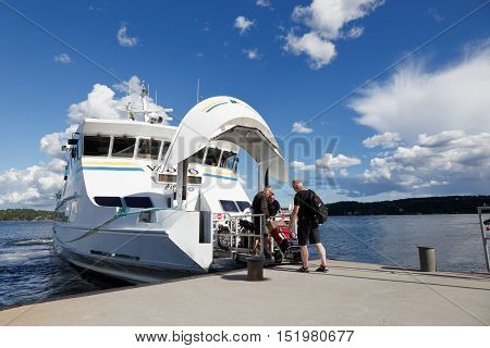 Lidingo, Sweden - July 4, 2016: The passenger ship ms Vaddo make a stop at Gashaga pier for passenger exchange. The ship service public transport operated by Waxholmsbolagets archipelago traffic in Stockholm county.