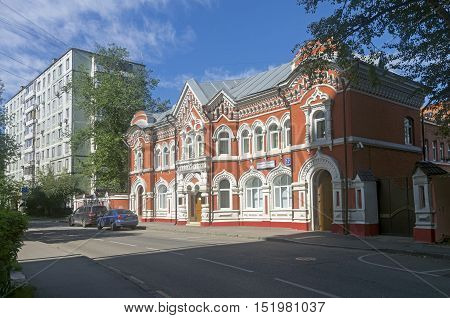 MOSCOW RUSSIA - JULY 31 2016: Old mansion built in pseudo-Russian style next to a modern apartment house.. 17 Bolshoy Rogozhsky lane Moscow Russia. Sunny July morning.