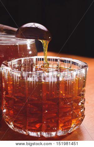 Honey Drip In Jar On Dark