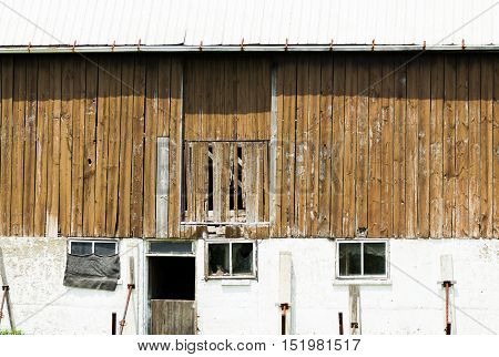 An old wooden barn on an abandoned farm in rural.