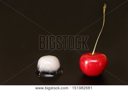 Sweet Cherry And  Ice Cube On Black Background