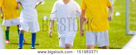 Boys playing soccer football game. Young soccer players on the pitch