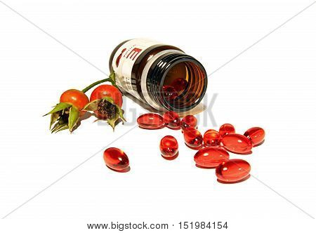 Capsules with vitamine E and the hips