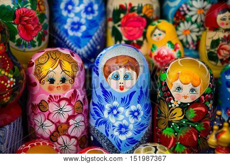 Souvenirs Russian nesting dolls. The doll is a wooden toy in the form of a painted doll, inside which are similar to her dolls smaller. Doll mother - symbol of Russia. National souvenir for tourists.