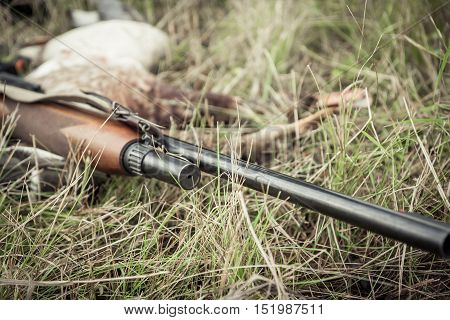Hunting gun on grass during duck hunting season