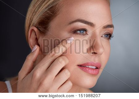 middle age woman looking skin on  her face