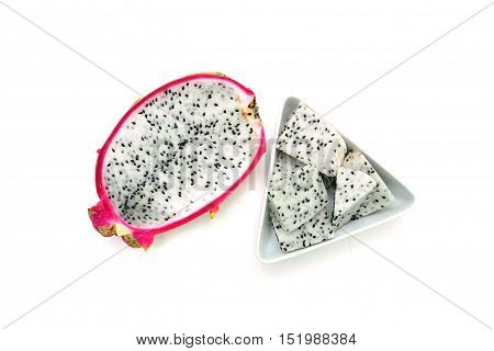 pitaya dragon fruit cross section with pieces in bowl isolated on white background