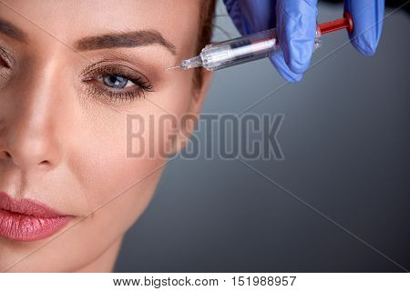 middle age woman on rejuvenation therapy with botox