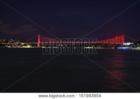 Istanbul bosphorus bridge with red lights at naight
