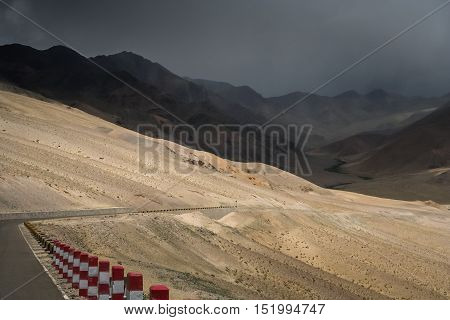Paved mountain road from Ali to Lhasa through the high central Tibetan plateau, Tibet, China