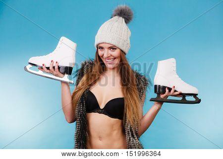 Woman Wearing Bikini Fur Vest With Ice Skates, Winter Sport